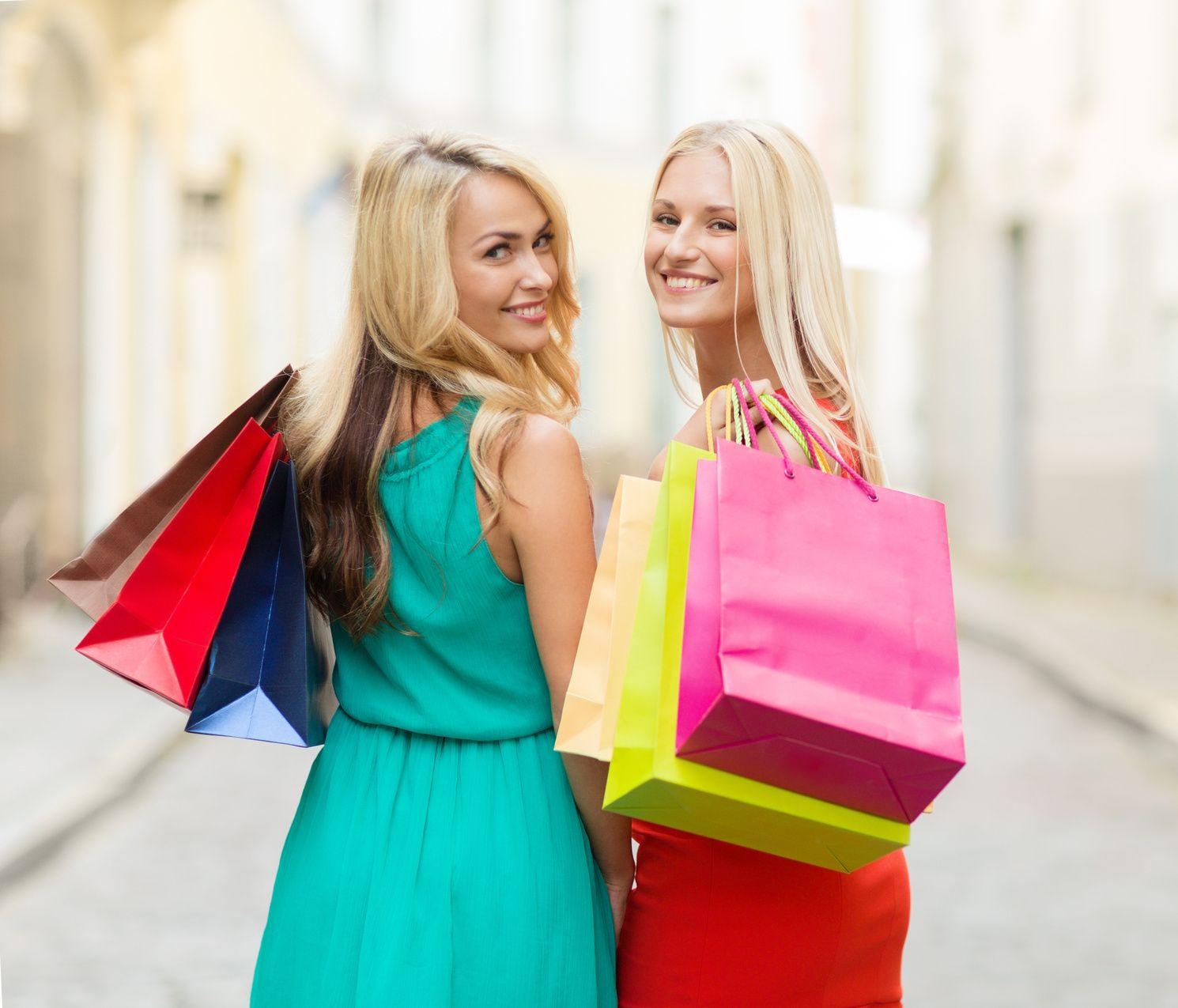 beautiful women with shopping bags in the ctiy